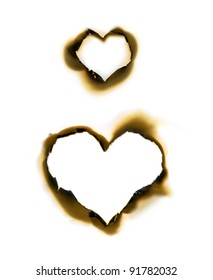 Sheet of parchment with heart shape burnt holes
