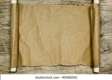Sheet of parchment on wooden table