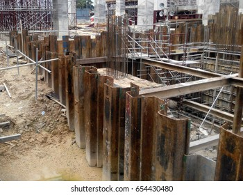 Sheet pile cofferdam retaining wall at the construction site. It is installed to allow soil excavation and foundation work start.