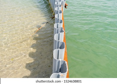 Sheet pile retaining wall on a sea shore. Recycled plastic in use. Water canal made easy. Sheet piling installed into the ground by driving or pushing. Cross-section and low weight.