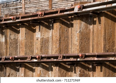 Sheet piling pile wall with soldier pile wall