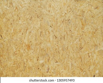 Sheet of plywood with compressed sawdust, tetxure