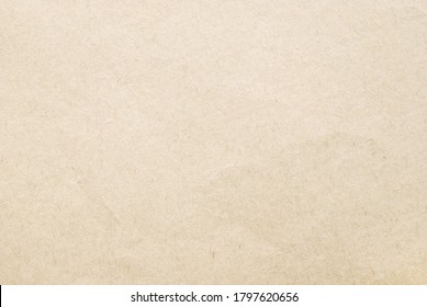 A sheet of rough beige recycled craft paper texture as background