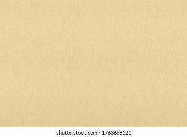 Sheet of textured light brown coloured creative paper background. Extra large highly detailed image.