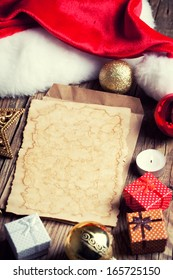 sheet of vintage paper with christmas decoration on wooden background