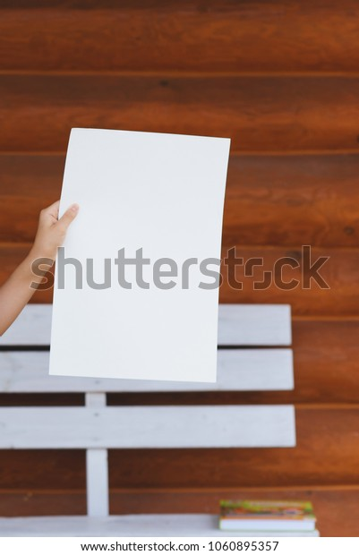 a sheet of white paper in hands