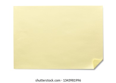 A sheet of yellow paper with a curved corner.