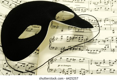 Sheetmusic With a Black Mask - Sheetmusic Background