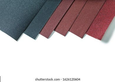 sheets of abrasive paper isolated on white background very close up