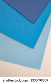 sheets of colored paper. Many colored sheets of paper are laid out in the harsh composition. background of colored paper. cold blue color.