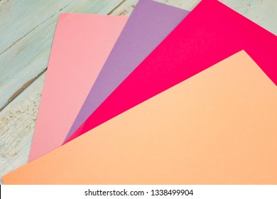 sheets of colored paper. Many colored sheets of paper are laid out in the harsh composition. background of colored paper.
