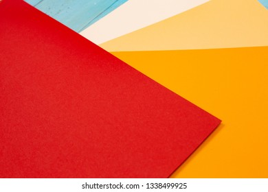 sheets of colored paper. Many colored sheets of paper are laid out in the harsh composition. background of colored paper. warm colors