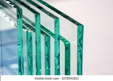 Sheets of Factory manufacturing tempered clear float glass panels cut to size - Shutterstock ID 1078341851