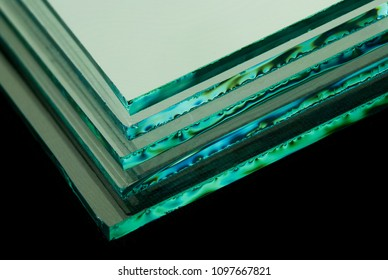 Sheets of Factory manufacturing tempered clear float glass panels cut to size.