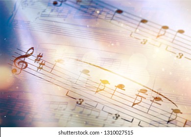 Sheets with music notes, close-up view