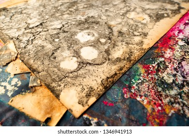 Sheets of paper damaged by chemicals. Corrosive acid-alkaline corrosive contamination conceptual background.