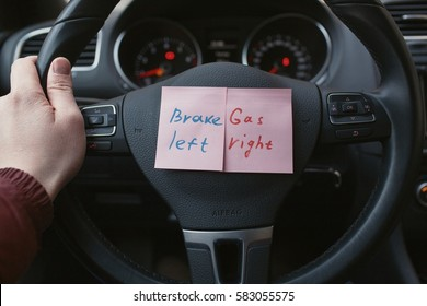 sheets of paper with a reminder where the gas, and where to brake the car.