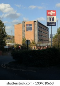 SHEFFIELD, ENGLAND - APRIL 1, 2018: Travelodge budget hotel with the Railway station park and ride sign in the foreground at Meadowhall Interchange, Sheffield, UK