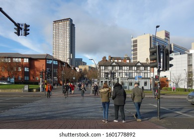 SHEFFIELD, ENGLAND - DECEMBER 7, 2019: People crossing Sheaf Street in the city centre of Sheffield, England