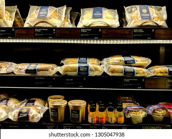 SHEFFIELD, ENGLAND - FEBRUARY 4, ‎2019:  A variety of sandwiches and cold drinks on shelves in a fridge at a branch of the Caffe Nero coffee shop chain, in Sheffield, UK