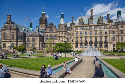SHEFFIELD, ENGLAND - MAY 7, 2009: The view of the of Peace Gardens with the Gothic building of Sheffield Town Hall on the background. Sheffield. England
