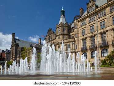 SHEFFIELD, ENGLAND – MAY 7, 2009: The view of the fountain in the Peace Gardens with the neo-Gothic building of Sheffield Town Hall on the background. Sheffield. England