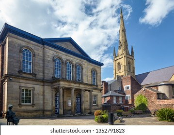 SHEFFIELD, ENGLAND - MAY 7, 2009: The view of the forecourt of Unitarian Upper Chapel with the tall spire of the Roman Catholic Cathedral Church of St Marie  on the background in Sheffield City Centre