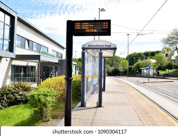 Sheffield England UK May 9 2018: Bus stop in Northern England with timetable screen on a sunny day.
