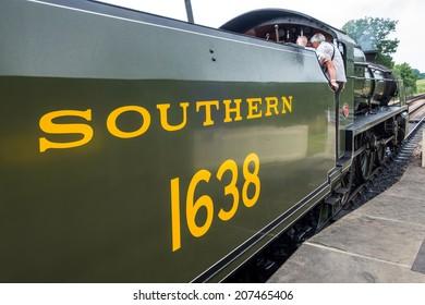 SHEFFIELD PARK, SUSSEX/UK - JULY 26 : U class locomotive at Sheffield Park station in Sussex on July 26, 2014. Unidentified people.