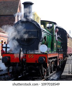 Sheffield Park, West Sussex / UK - 09/24/2017: British Railways Standard Class 5MT 4-6-0 No 73082 'Camelot' pulling Golden Arrow dining carriages into Sheffield Park Station on the Bluebell Railway.