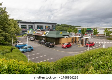 Sheffield, South Yorkshire, England - July 2 2020: Cars queueing at a McDonalds drive through as the UK comes out of the national lockdown.