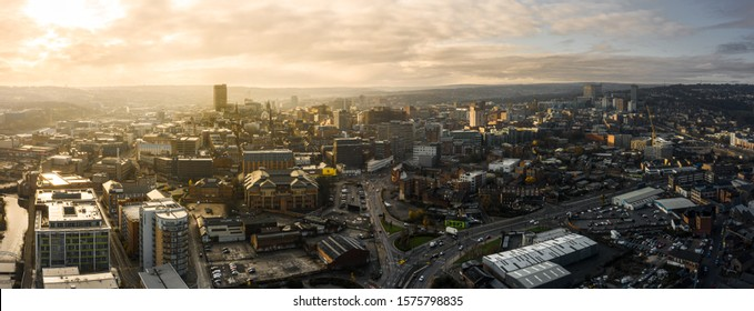 Sheffield, UK - 1st December 2019: Aerial Panoramic view above Sheffield City during frosty winter morning with golden sunrise