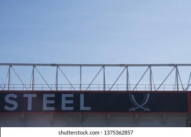 Sheffield / UK - April 20, 2019: Sheffield United Football Club, Bramall Lane 'Forged in Steel' logo on stadium exterior