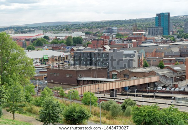 SHEFFIELD, UK - AUGUST 9, 2018: City Centre of the town of Sheffield seen from the Sheaf Valley Park, a former industrial hub famous as the Steel City.