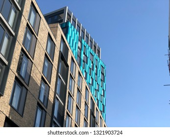 Sheffield / UK - February 24 2019: Low angle view of New Era Development in Sheffield City Centre with clear blue sky