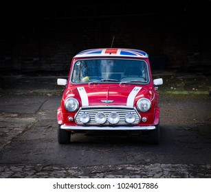 SHEFFIELD, UK - FEBRUARY 9, 2018.  A classic, red Mini Cooper in John Cooper Works trim with headlamps and fog lamps Andy a Union Jack roof.