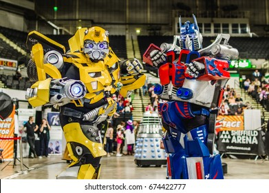 Sheffield, Uk - June 03, 2017: Cosplayers dressed as 'Bumblebee' and 'Optimus Prime' from the Transformer series at the Yorkshire Cosplay Convention at Sheffield Arena.