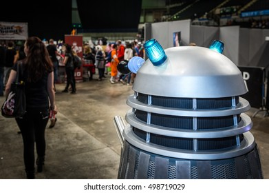 Sheffield, UK - June 11, 2016: Dalek model following a woman at the Yorkshire Cosplay Convention at Sheffield Arena