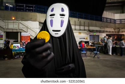 Sheffield, UK - June 12, 2016:  Cosplayer dressed as the character 'No Face' from the Studio Ghibli film 'Spirited Away' at the Yorkshire Cosplay Convention at Sheffield Arena
