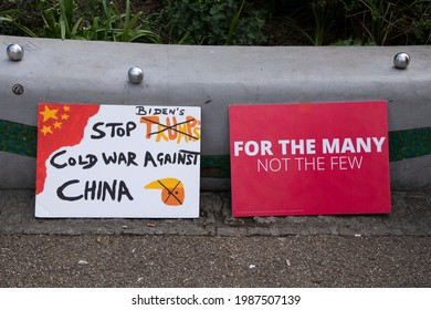 Sheffield, UK: Stop Biden's Cold War Against China  For the Many Not the Few old signs at 1st May 2021 International Day of Workers event, Devonshire Green
