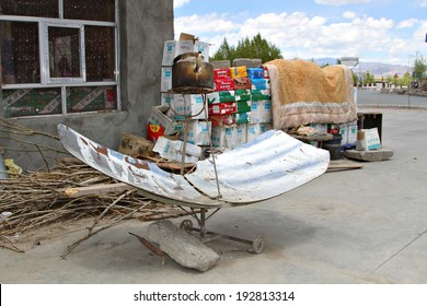 Shegar, Tibet, China - 9 May 2014: A kettle sits above a reflective sun dish, being heat by concentrated solar energy being reflected onto the bottom of the kettle to boil the water inside.
