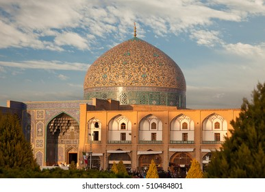 Sheikh Lotfollah Mosque in Naghshe Jahan or Imam Square of Isfahan, which is one of the UNESCO World Heritage sites and is illuminated by a warm sunset.