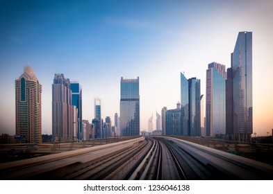 Sheikh Zayed road and metro railway. Sunrise in Dubai.