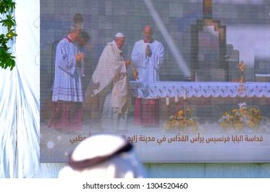 Sheikh Zayed Sports City, Abu Dhabi, UAE - 5th February, 2019: Devotees watching Pope Francis on big screen During Pope Francis visit in Abu Dhabi, UAE