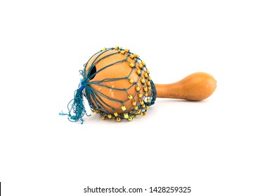 The shekere is a West African percussion instrument consisting of a dried gourd with beads or cowries woven into a net covering the gourd.