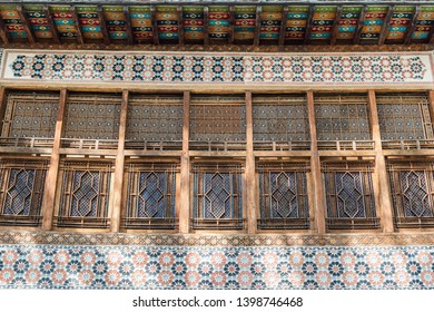Sheki, Azerbaijan - April 29, 2019. Windows of the Palace of Sheki Khans in Sheki, Azerbaijan. Mosaics of colored glass are set in a wooden latticework (shebeke) that was assembled without nails.