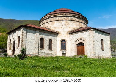 Sheki, Azerbaijan - April 29, 2019. Exterior view of dome-roofed circular church building, probably Caucasian Albanian, dating from 5th-7th century, in Sheki, Azerbaijan.