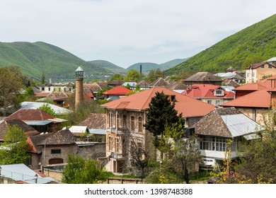 Sheki, Azerbaijan - April 29, 2019. View over downtown area of Sheki town in Azerbaijan, with historical buildings and mosque.