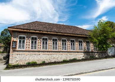 Sheki, Azerbaijan - April 29, 2019. Exterior view of a historic building in Sheki, Azerbaijan, currently housing a children medical institution.