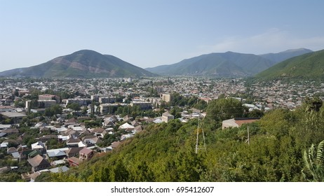 Sheki, Azerbaijan - August 14, 2017 - View over Sheki with the Great Caucasus mountains at the background